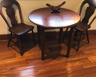 sweet children's antique table with carved back chairs