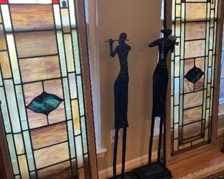 2 large stained glass windows and cast iron musical statues