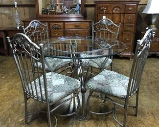 Cute round glass table and four chairs