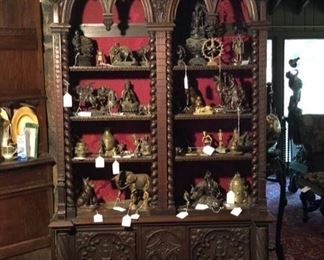 Fabulous gothic cabinet and shows some of the many bronze and other metal figures to choose from.