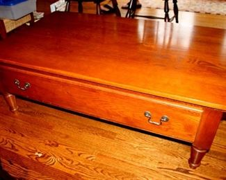"ONLINE AUCTION ITEM #3 - Keller oak coffee table with drawers on each side - approximately 50"" long, 30"" wide, 18"" tall."