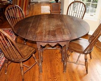 "ONLINE AUCTION ITEM #6 - Gate-leg table with Pottery Barn chairs - table approximately 57.75"" diameter."
