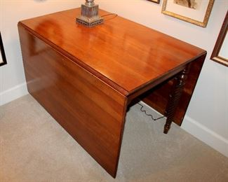 "ONLINE AUCTION ITEM #14 - Drop-leaf table - approximately 92"" long including leaves, 26.5"" wide."