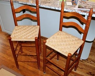 "ONLINE AUCTION ITEM #20 - Three woven seat ladder back barstools -seat approximately 25"" tall on 2 larger ones, 22.5"" tall on smaller one."