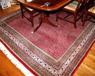 ONLINE AUCTION ITEM #24 - Large red Oriental area rug - approximately 13.5 feet x 8.25 feet.