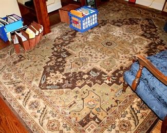 ONLINE AUCTION ITEM #25 - Brown area rug - approximately 7.75 feet x 10.75 feet.