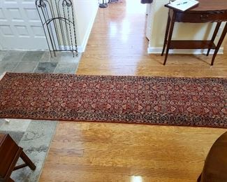 "ONLINE AUCTION ITEM #51 - Red Oriental runner - approximately 10'5"" x 2'7""."
