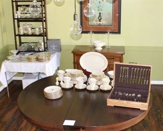 The dining room has beautiful furniture, china, flatware and crystal.