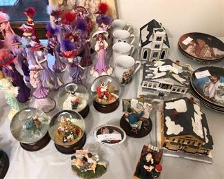 Norman Rockwell snow globes, plates, cups, and houses