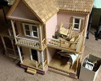 Large unfinished doll house. Three feet tall by four feet
