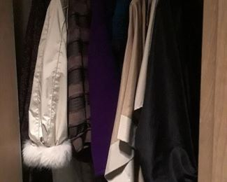 Fur lined raincoat or opera coat and other wraps.