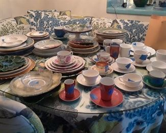 Various sets of dinnerwares waiting to be counted and priced.