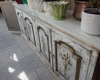Shabby chic console with great storage is in the atrium.