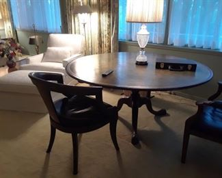 One of three round table. One with three leaves to seat 12-15, one with drop down sections to become square. All designer quality. All priced to sell.