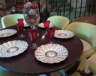 Unusual mirrored chargers, Service for 12 red stemware, chairs are priced to sell.