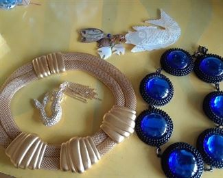 More WOW jewelry, including the mermaid pin and the mother of pear fish at top.