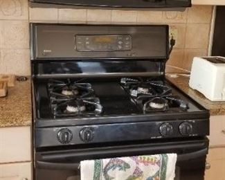 Kenmore gas range & microwave oven. Microwave oven manufactured 1/2000.