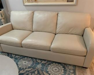 Palliser Leather sleeper sofa and loveseat less than 2 years old in new condition.