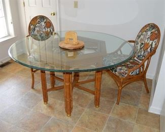Glass top table with 6 chairs (only 2 pictured)