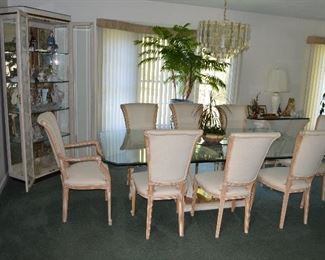 Glasstop table with stone base and 8 chairs