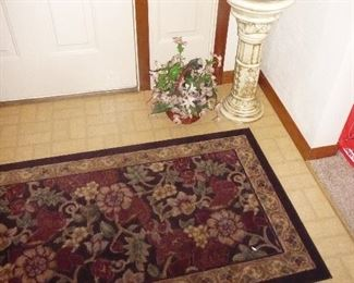 plant stand / rug