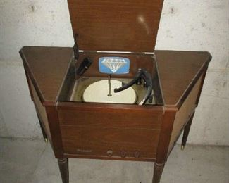 Record player in cabinet by Magnavox