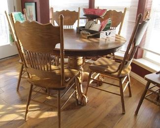 Oak table with six press back chairs