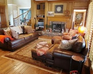 Leather Pottery Barn sofa, chairs and ottomans.