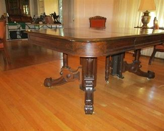 "Walnut Dining Table, Eastlake style, split pedestal when open, 50""W  - 50""L closed or 70""L open,  Late 19th Century"
