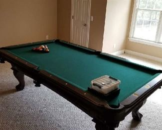 Thomas Aaron Pool Table is near perfect condition. Asking $950 and is negotiable. Comes with Cues, balls, rack etc. Clock sold separately. Pick-up arrangement can be discussed with family if not on sale days