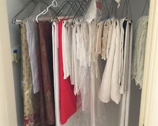 beautifully ironed cloths and decoratives, as well as throws, etc.
