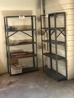 two racks join the ladder and other utilitarian things in the basement.