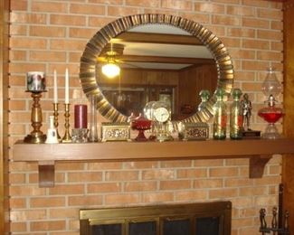 Beveled glass mirror, gold and black, brass candlesticks, kerosene lamp.