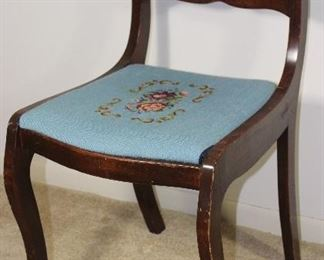 Mahogany Duncan Phyfe Style carved back side chair with needlepoint seat.