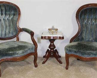 "Victorian Carved Wood Frame Lady's and Gentleman's Chairs Blue rolled and tufted velvet upholstery  shown with White marble top small Pedestal Victorian Style Side table/plant stand, 14"" W x 14"" D x 19"" H and gold encrusted glass 3 toed Candy Dish"