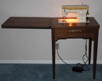 Singer zigzag sewing machine model 360 in wood cabinet c. 1975