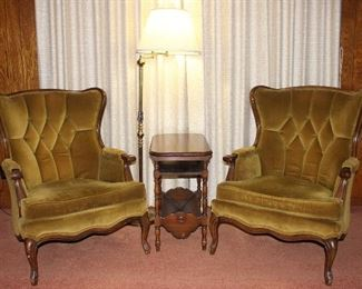 Vintage Wood Frame Tufted Winged Chairs shown with Depression Era Occasional Table with book trough and brass adjustable arm floor lamp