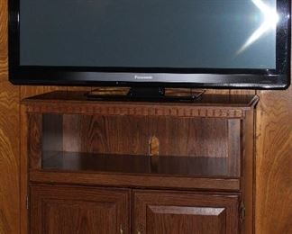 "Panasonic 2011 42"" Smart TV shown with TV/Microwave Stand"