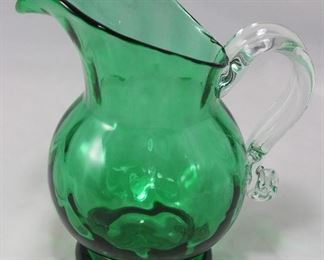 "Blown glass green pitcher with clear applied handle (7 1/2"" H)"