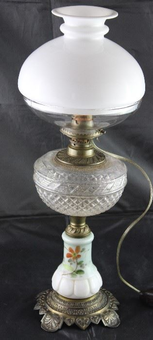 Antique oil lamp with hand painted base patterned glass font milk glass globe on clear glass vase with electrical added
