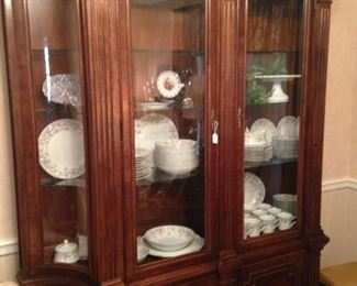 Another china cabinet filled with china