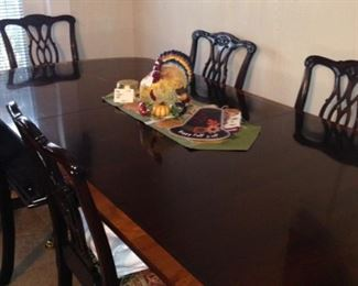This Pennsylvania House 2-pedestal dining table has additional leaves.