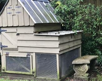 chicken coop and cement bench