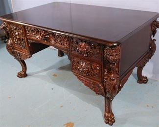 060b  Mahogany heavily carved partners desk with wing griffins, attrib. to Horner, 31 in. T, 56 in. W, 34 in. D.