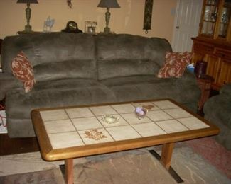 couch, and coffee table that adjusts to table height