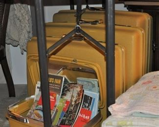 Vintage set of Samsonite (with original boxes), maps and travel brochures, stack of vintage and antique quilts