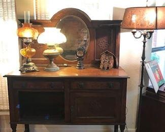 Antiques Buffet.  Double Globe Lamp.