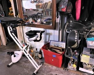 Vintage liquor bottles, gorgeous huge wood mirror, lots of art, antique Mexican saddle made with black leather and silver, sports playing cards, music CDs, and more...