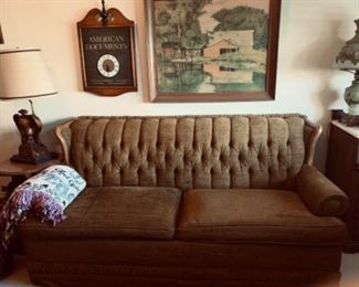 Hide a bed sofa with wood trim - in great condition