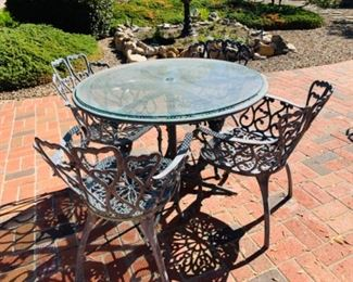 Patio table w/glass top and four chairs, cast aluminum